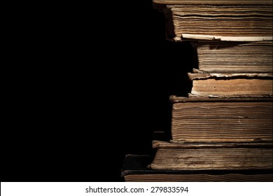 Old books in a stack isolated with space for text