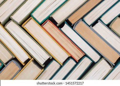 Old books and textbooks in hardcover the view from the top. Concept of education