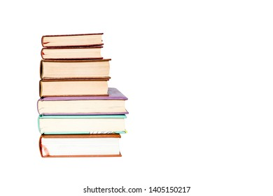 Old books vintage top each over on white background isolated, collection aged book concept.