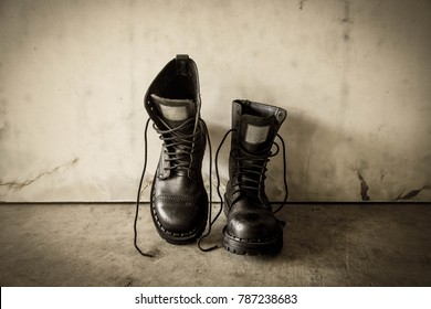 Old boots on grunge background,Fashion