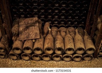 Old bottle in a Beaune's winecellar