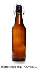 old bottle of beer with drops isolated on white background