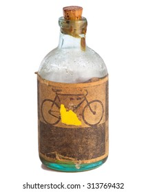 Old bottle with machine oil isolated on a white background