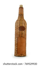 Old bottle in a wicker shell, isolated on a white background