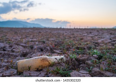 Old bottles on dry ground