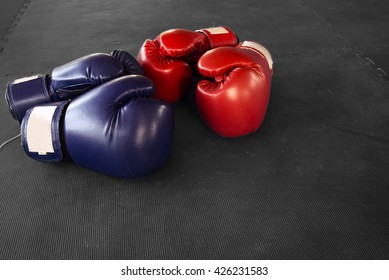 old boxing gloves hang on nail on texture wall with copy space for text. Retirement concept