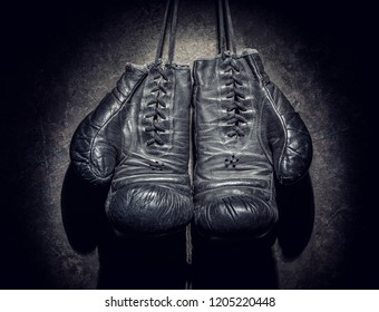 old boxing gloves on a dark background