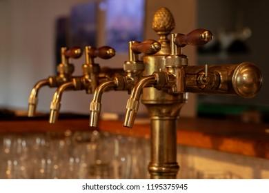 Old brass beer spigot on bar