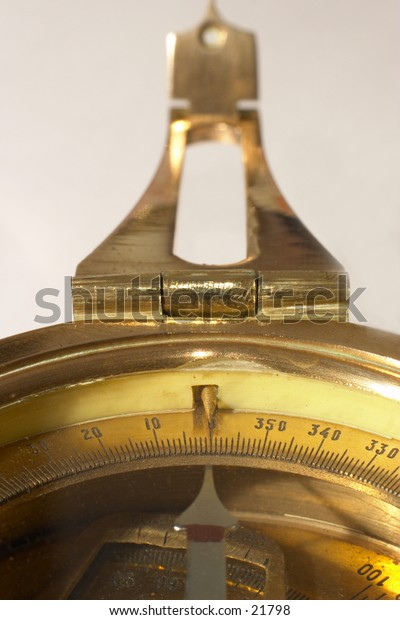 Old brass compass with it's needle pointing north. Symbolising the right course.