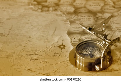 An old brass compass on a map background