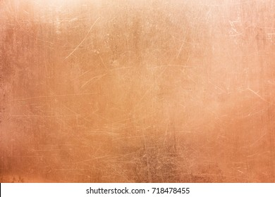 Old brass or copper background, texture of a vintage orange metal plate