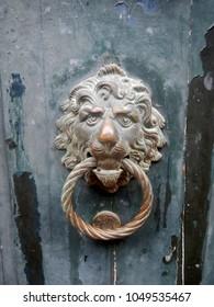 Old brass door knocker, lion's head, Venice