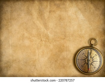 old brass or golden compass with vintage map background