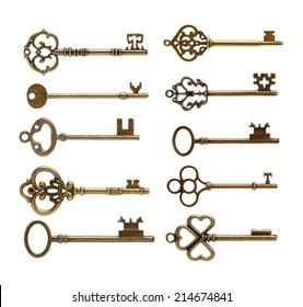 old brass key against a white background