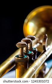 old brass trumpet on a black background