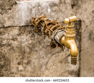 old brass water tap with chain bind on it use for bring water from mountain to local village in Nepal, water is very important for life, poor country need safe water for life.