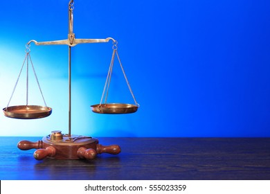 Old brass weight scales on blue background with free space