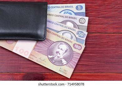 Old Brazilian money in the black wallet