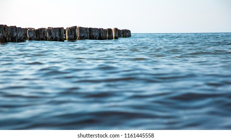 old breakwaters in the sea