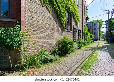 Old Brick Alleyway next to Residential Buildings in Logan Square Chicago