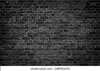 Antigua pared de color negro de ladrillo. Fondo de cosecha