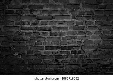 Old brick black color wall. Vintage background