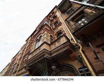 Old brick building facade istorism neorus architectural style at Kolokolnaya street 11, St-Petersburg, Russia. 27 June 2017