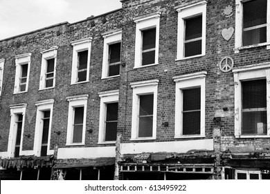 Old brick building showing two rows of windows shot in black and white in Camden, England.