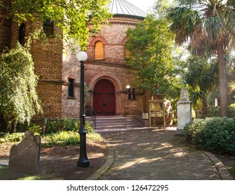 An old brick church in Charleston, South Carolina with a round entry