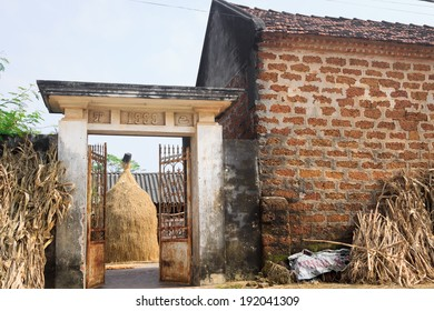 old brick construction with red tiled roof, wall and gate in the Duong Lam, ancient village, Vietnam.