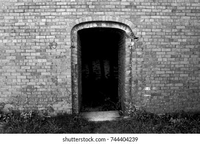 Old Brick Doorway Leading to a Dark Room - Black and White