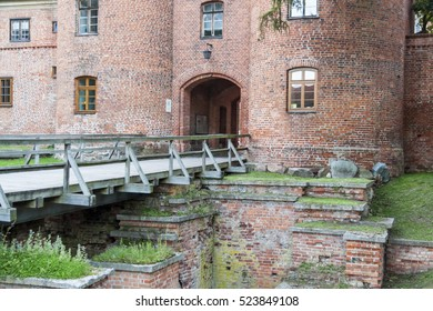Old brick gate to fortification in Frombork - Poland.
