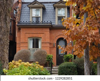 old brick house with slate mansard roof