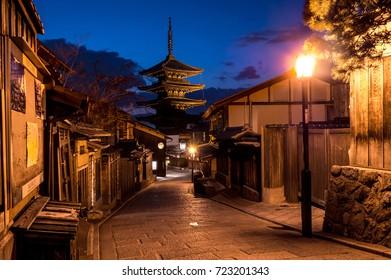 Old brick street to Yasaka pagoda with evening twilight sky in Gion. Kyoto, Japan.