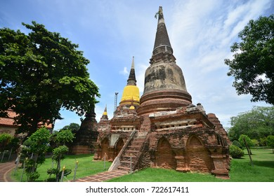 Old brick temple and statue of buddha. Historical national park, Ayuthaya, Thailand