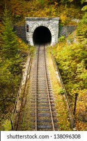 Old brick tunnel in the mountains in autumn/Train tunnel