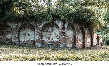 Old brick wall. Arches in the wall