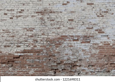 old brick wall background. painted in white color red bricks