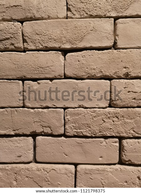 Old brick wall in brown color