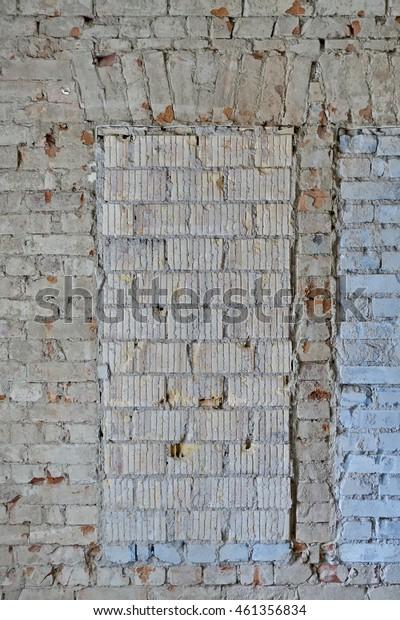old brick wall closed window