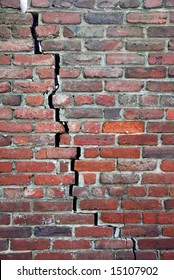 An old brick wall with a crack going right through