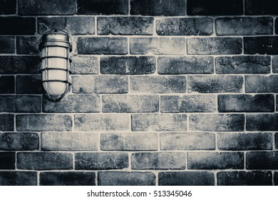 old brick wall in dark black and white mono vintage tone.