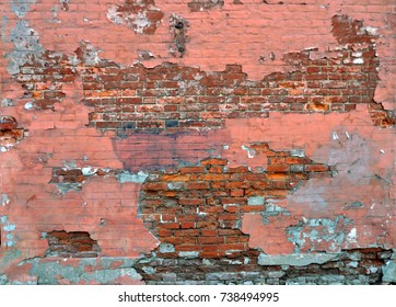 Old brick wall distressed painted red with crumbling plaster textures and backgrounds