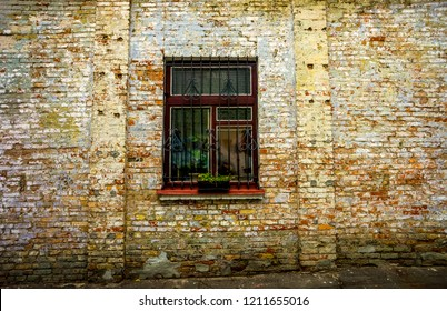 Old brick wall with brick filled window with dark dirty black glass as zombie land - Shutterstock ID 1211655016
