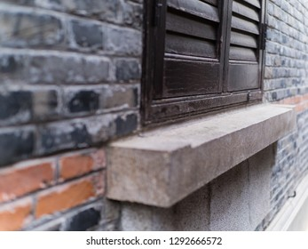 Old brick wall with brick filled window
