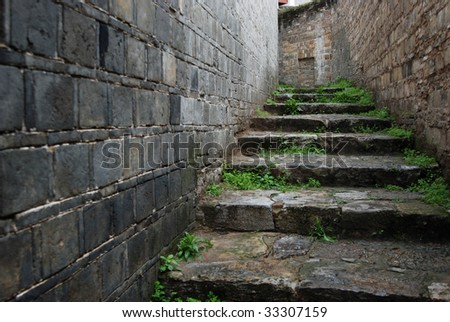 Old Brick Wall And Old Flagstone Stairs Of A Lane