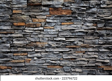 Old brick wall from a flat stone