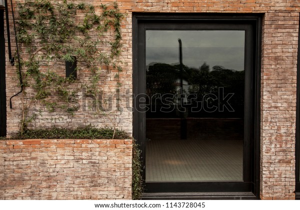 Old brick wall and a glass door.