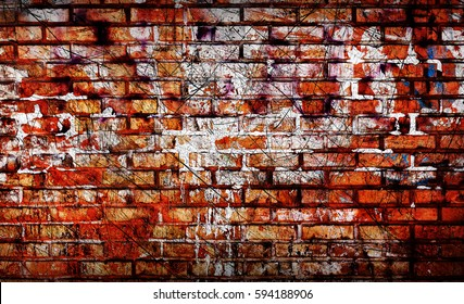Old brick wall with graffiti elements