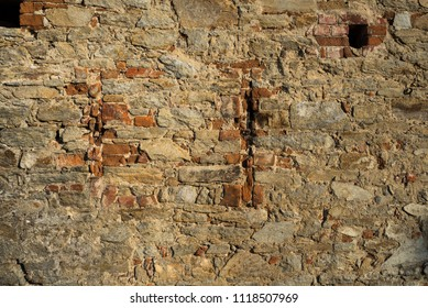 Old brick wall with holes